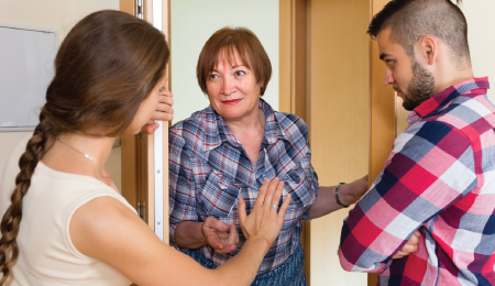 couple opening door for a mature woman